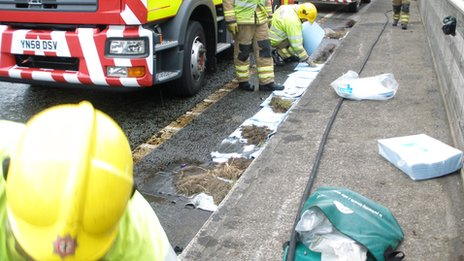 Firefighters blocking drains