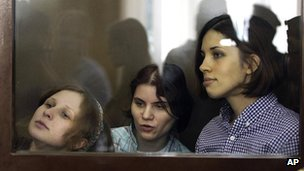 Three members of the Russian punk band Pussy Riot - Nadezhda Tolokonnikova (r), Mariya Alekhina (l) and Yekaterina Samutsevich (c) - pictured during their trial on hooliganism trial at Moscow's Khamovniki court on 30 July 2012