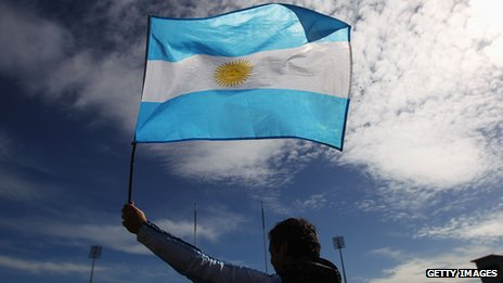 Man carrying Argentinan flag