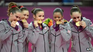 Team USA gymnasts with their gold medals
