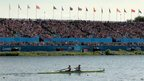 Crowds watch Heather Stanning and Helen Glover rowing