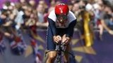 Bradley Wiggins is cheered on by the crowds on his way to gold in the road race time trial