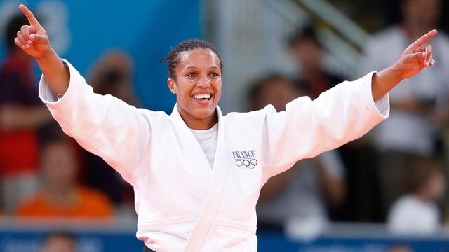 Lucie Decosse celebrates winning gold medal for France in women's under-70kg judo final.