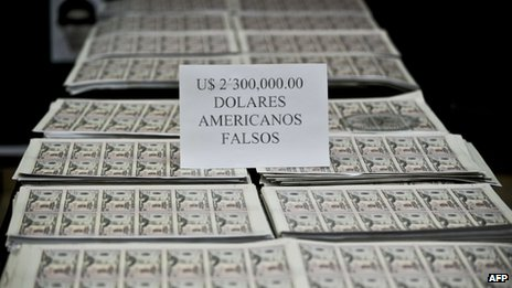 Peruvian police displays fake dollar bills seized