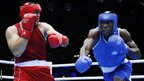 Magomedrasul Medzhidov of Azerbaijan defends against Meji Mwanba of the Democratic Republic of the Congo