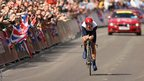 Great Britain's Bradley Wiggins crosses the line to win the men's individual time trial at Hampton Court Palace