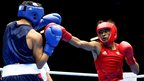 Lazaro Alvarez Estrada of Cuba in action with Joseph Diaz Jr of United States