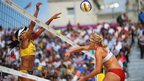 Juliana Silva of Brazil jumps at the net with Hana Klapalova of Czech Republic