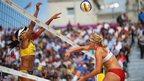 Juliana Silva of Brazil jumps at the net with Hana Klapalova of Czech Republic