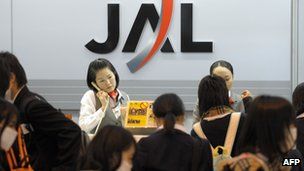 Passengers at a JAL counter in Japan