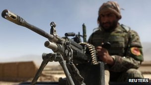 An Afghan National Army soldier keeps watch near the site of the gunbattle in Kabul August 2, 2012.