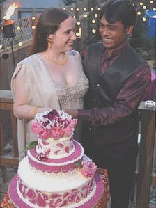 Javed Mohammad and Cristina Marie Kameika cut their wedding cake at ceremony in Atlanta, USA. 