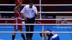 Japan's Satoshi Shimizu stands over Magomed Abdulhamidov of Azerbaijan