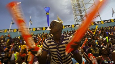 Fans cheer during Jamaica's Inter-Secondary Schools Boys and Girls Athletics Championships, also known as Champs, in Kingston, 31 March 2012