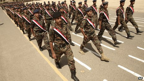 Yemeni soldiers march during a ceremony to commemorate their colleagues who died in a suicide attack (File)