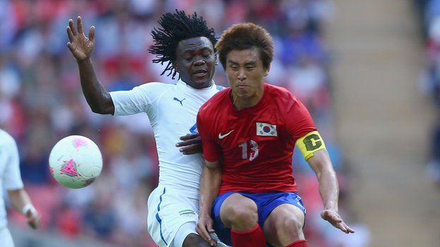 Jacheol Koo of Korea Republic is challenged by Franck Engonga of Gabon