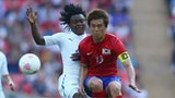 Jacheol Koo of Korea Republic is challenged by Franck Engonga of Gabon