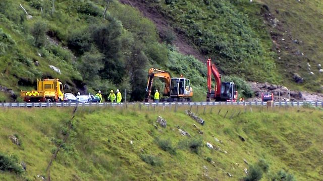 Engineers assess a landslip on the A83