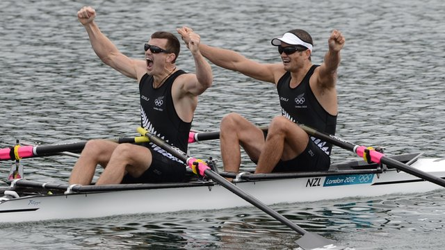 Joseph Sullivan and Nathan Cohen celebrate winning gold medal in men's double sculls.
