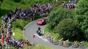 Cyclists on a hairpin bend at the base of the Box Hill climb