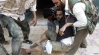 A Free Syrian Army fighter is wounded during a fight with forces loyal to Syrian President Bashar Al-Assad in central Aleppo on 1 August 2012