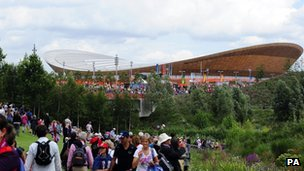 Fans in the Olympic Park walk near the velodrome during day six of the Games