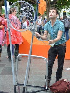 Andy Dangerfield playing games made from scrap metal outside National Theatre