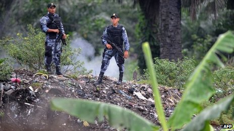 Soldiers standing guard in a plantation of the Bajo Aguan valley - file photo August 2011