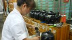 Traditional Chinese medicine being poured into a container
