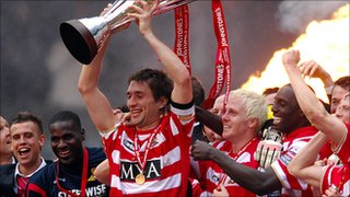 Graeme Lee lifts the Johnstone's Paint Trophy