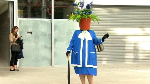 Woman with flowerpot on head