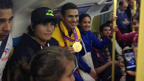 Ruben Limardo Gascon shows off his gold medal on the tube