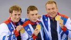 Jason Kenny (l), Philip Hindes (c) and Sir Chris Hoy (r) collect their gold medals after winning the men's team sprint.