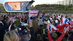 Fans gather in the Olympic Park to watch Sir Chris, Hindes and Kenny win gold in a new world best time of 42.6 seconds.