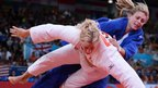 Gemma Gibbons grapples with Kayla Harrison in the judo 78kg women's final