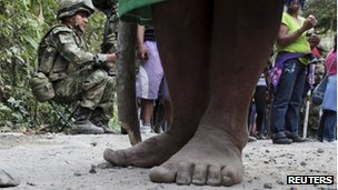 Members of an indigenous group and a soldier in Cauca province