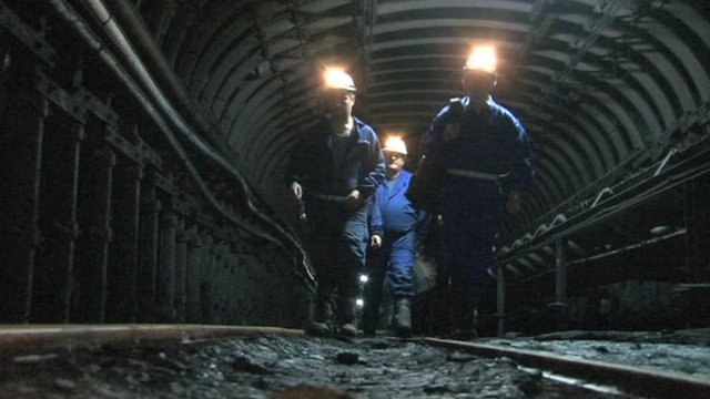 Spanish miners in a mine