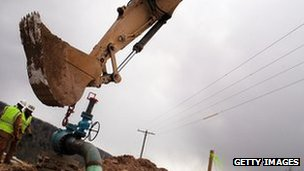Men work on a natural gas valve at a hydraulic fracturing site South Montrose, Pennsylvania.