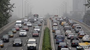 Vehicles are stuck in heavy traffic at the Third Ring Road in Beijing, 27 July 2012