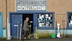 Man standing outside a shop on Tarbert
