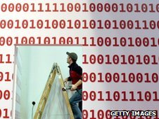 A man works on a booth as preparations are under way for the CeBIT IT fair on February 28, 2011 in Hanover