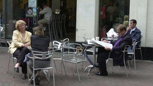 People sitting outside a cafe