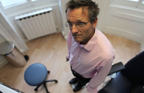 Michael Mosley checks his weight
