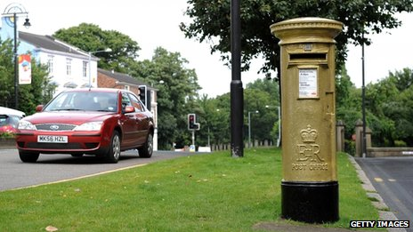 Gold-painted postbox