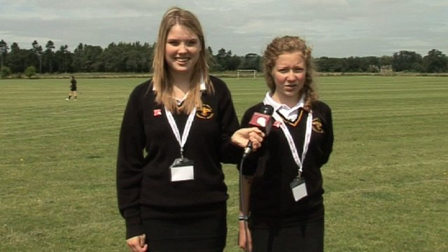 School Reporters from Reading standing next to a hockey pitch
