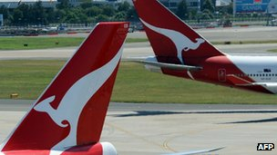 Two Qantas Boeing 747s crossing paths at Sydney International Airport in November 2011.