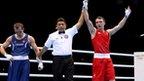 Freddie Evans celebrates after defeating Egidijus Kavaliauskas