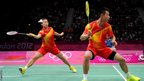 Jin Ma lunges for a shot as she and Chen Xu of China compete in the mixed doubles badminton gold medal match
