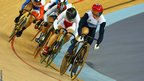 Victoria Pendleton holds onto a tight lead over Shuang Guo of China in the women's keirin final
