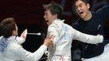 South Korea celebrate winning the men's team sabre
